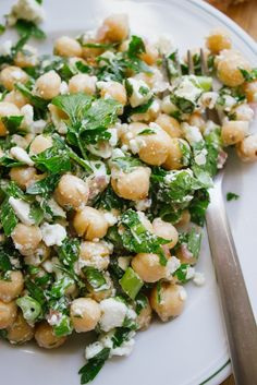 Chickpea, Feta and Parsley Salad red onion, garlic, olive oil, red chili flakes, chickpeas, scallions, parsley, lemon, feta, salt and pepper
