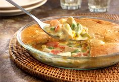 Cream of chicken soup, frozen veggies,chicken and a biscuitcrust put the easy in this delectable chicken pot pie that bakes in only 30 minutes! It's so tasty, it just might become your go-to recipe.