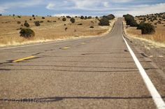 I've always wanted to drive on a road like this. Wide open fields of nothingness on either side