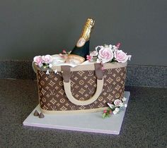 for 21st BD; purse is fondant with GP cut puts for logo; LV is piped royal; bottle half is molded green choc.