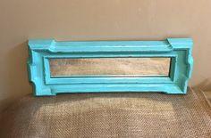 A personal favorite from my Etsy shop https://www.etsy.com/listing/518200292/vintage-aqua-mirror-distresed-aqua