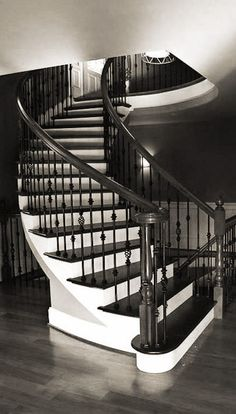 custom stairs featuring turned newels and wrought iron balusters