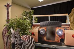 #CampKilimanjaro :: A faux jeep front and animals make great decorations! #VBS2015