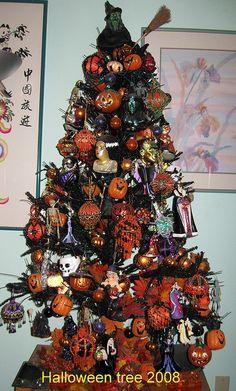 Halloween décor - in addition to jack o-lanterns and other bewitching ornaments, there are several beaded in the style of the Victorian ones seen in Christmas colors, except they are in black and orange.  Also a purple one and a green one.