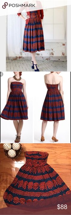 """🏵ANTHROPOLOGIE🏵OXIDIZED MEDALLION DRESS🏵 Girls from the Savoy, fit and flare jersey stretch, side boning in bodice, back zipper, polyester spandex blend, built in navy blue petticoat. Rust and Navy dress. 92% polyester 8% spandex . Lining 100%  polyester MEASUREMENTS flat Bust-14 1/2"""" Waist- 13 1/2, Hips-Free, and Length-36"""".🏵ANTHROPOLOGIE🏵OXIDIZED MEDALLION DRESS🏵 Anthropologie Dresses Strapless"""