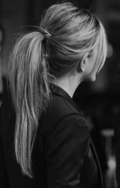 two hair ties to give the ponytail extra bounce; second one clear and covered with strand of hair wrapped around it and tucked in