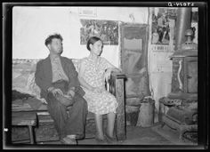 Arthur Rothstein. Unemployed coal miner and wife living in old barn. Herrin, Illinois. 1939 Jan. Library of Congress.