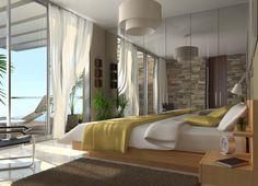 Dormitorio principal de una de las viviendas de Conil de la Frontera (Cádiz) con vistas al mar.