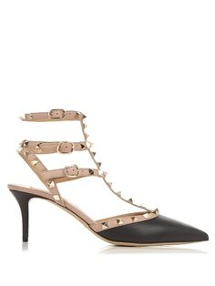 Few shoe designs have garnered the coveted status of Valentino's pointed Rockstud pumps. This pair is a true classic – they're crafted from smooth black leather with soft mauve straps, and finished with those iconic gold-tone metal pyramid studs. They'll work with jeans and trousers by day, and full-skirted dresses come evening.