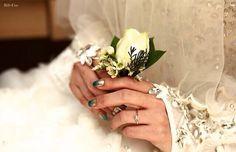 Bride holding groom's corsage