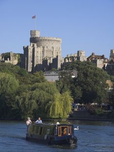 The River Thames with Windsor Castle, England. Boat journeys on the river are great way to see diff view of the city