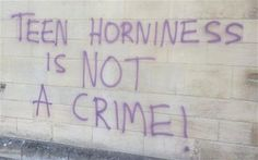 Graffiti on the wall of Rochester Cathedral stating that 'Teen horniness is not a crime'