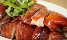 Roast duck -- Authentic Chinese food often looks nothing like American Chinese food. It varies tremendously by region. Popular Chinese Food, Real Chinese Food, Authentic Chinese Recipes, Order Chinese Food, Braised Duck, Braised Chicken, Duck Recipes, Gourmet Recipes, Chinese Chicken Wings