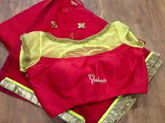 YBA097: Red with neon green saree and blouse from Yoshnas By Ela.They can customize the size and colour as per your requirement.To order please reach on 7550227897 / 044 43331240. 17 October 2017