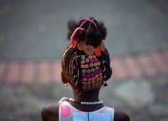 Luis Robayo—AFP/Getty Images May A girl presents an Afro-Colombian hairstyle during the contest of Afro-hairdressers, in Cali, Valle del Cauca departament, Colombia. Black Is Beautiful, Beautiful People, Curly Hair Styles, Natural Hair Styles, Presents For Girls, American Children, Afro Hairstyles, Children Hairstyles, Black Hairstyles