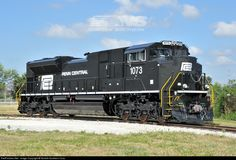 Penn Central 1073, Norfolk Southern's eighteenth heritage unit, poses outside the shop in Muncie. For more information, visit www.nscorp.com