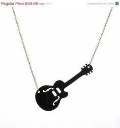 - Black Guitar Pendant Necklace - #fashion #style #music #jewelry #necklace #pendant #guitar #musicfashion http://www.pinterest.com/TheHitman14/music-jewelryaccessories-%2B/