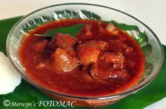 Pork Vindaloo - an authentic recipe by a Goan. The authentic pork vindaloo is not too spicy. It is tangy and mildly spicy.