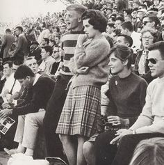 Plaid skirt, striped sweater.