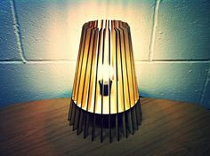 A beautiful Scandinavian inspired lamp design laser cut from 3mm FSC accredited birch plywood This lamp is 30cm high x 24cm wide SHADE SUPPLIED ONLY