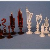 Lot 113 - An Ivory chess set depicting Musical Instruments. Est £4,000 - £6,000