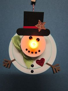 Krafting with Karen: Flameless Candle Snowman Ornament. Leave off the body and j… Krafting with Karen: Flameless Candle Snowman Ornament. Leave off the body and just use head. Christmas ribbon for scarf. Use paint pen for eyes and mouth right on surface. Fun Crafts For Kids, Christmas Crafts For Kids, Christmas Projects, Holiday Crafts, Christmas Ideas, Snowman Crafts, Snowman Ornaments, Diy Christmas Ornaments, Christmas Decorations