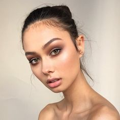 In this image, you can really tell the makeup that she has on. Even though her whole face is showing, her eye makeup stands out. Her pose is also interesting as well