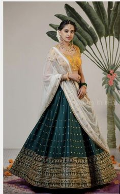 Latest designer green color lehenga choli for wedding For order whatsapp us on wedding outfits wedding dress wedding dresses lengha lehnga sabyasachi manish malhotra Indian Gowns Dresses, Indian Fashion Dresses, Dress Indian Style, Indian Designer Outfits, Designer Dresses, Indian Designers, Designer Clothing, Indian Lehenga, Half Saree Lehenga