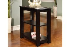 """End Tables F6262 $59 Modern architecture is defined with this chair side accent table in a black wood finish. It features two lower shelf's for display.  Dimensions  24"""" x 12"""" x 24""""H     Materials  Rubber Wood Particle Board"""