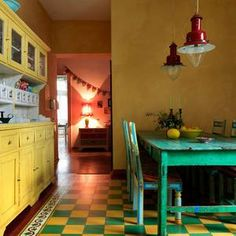 Green and yellow kitchen...so fun. Vintage pieces, industrial lighting. Speaking EPIC language :)