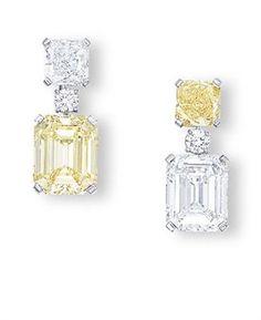 A PAIR OF COLOURED DIAMOND AND DIAMOND EAR PENDANTS, BY CARTIER. Via Christie's; sale price $515,016.