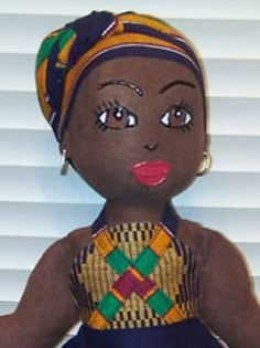 Wamuiru 3- OOAK, Black, African American, Handmade Dolls of Color, Black Cloth Dolls, Black Dolls Matter, Ethnic Dolls. Name Definition: Wamuiru (WAH-moh-ee-roh)- A dark skinned beauty. Wamuiru 3 is a 15 inch Baby Girl dressed in an African inspired black print with gold, orange, green and red Kente stripes with coordinating head wrap. Wamuiru 3 was the 1st edition of this design and the 4th with this fabric which was first used in the collection in 2006. *Future editions of this cuties…