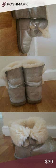 Authentic silver uggs with button Girl uggs. Worn but plenty of life left. Can be rolled up or down. UGG Shoes Boots