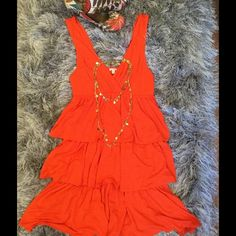"⛵️J. Crew ruffle dress ⛵️ Size small orange J. Crew dress is super bright, fun and flirty. Hits at knees (I'm 5'2"") 100% cotton. Great wash and wear. Ideal for sunshine and fun. Thank you for shopping and let me know inflow have any questions. Happy Poshing!!!  J. Crew Dresses Mini"
