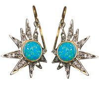 Un Hada Starbit earrings in 14k gold and silver with opal centers and 0.50 ct…