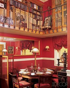 Jewelry designer Kenneth Jay Lane's Manhattan duplex features a double-height dining-and-mezzanine area saturated in dramatic red.