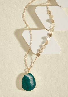<p>When you use this long pendant necklace as a visual aid for your inner vivacity, onlookers will crave an intellectual convo with you! Hanging from an adjustable gold chain that boasts glistening disc accents, this deep green geode charm is a rad representation of your awesome essence.</p>
