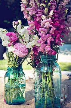 This is what my table centerpieces looked like at my wedding. The flowers were different.but had the blue Mason jars! snap dragons and mason jars. Unique Wedding Centerpieces, Unique Weddings, Wedding Decorations, Jar Centerpieces, Centerpiece Ideas, Ranunculus Centerpiece, Purple Centerpiece, Rustic Weddings, Table Decorations