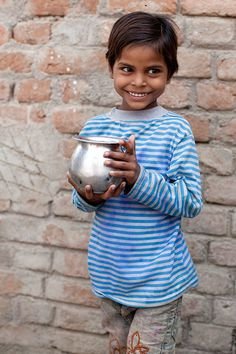 About to take a sip of clean water in Budhaura, India. Water changes everything. (photo: Mo Scarpelli)