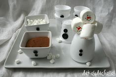 Snowman hot cocoa bar ideas... Love the buttons on the cups and containers & the candy cane marshmallow snowmen stirrers...