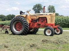 """The old Case tractor - I first """"drove"""" it when I was a preschooler, steering it through the fields as Dad ran and picked up bales of hay."""