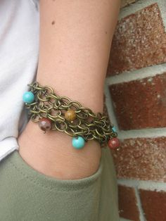 Chain Mail Beaded Charm Bracelet  @Janie Haataja {maybe you need to make yourself some jewelry to go with your coat}