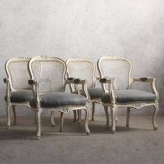 Darling vintage Louis XV armchairs in a weathered white finish and storm grey upholstery with cane backs. The perfect delicate touch for any room.brbr36H x 25W x 26DbrSeat Height: 18brArm Height: 25brCirca: 1940brbrReturn Policy:br This item is not eligible for returns or exchanges so please make sure to look over the pictures and ask questions before purchasing this beautiful piece.