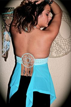 A beautiful hand made top, with a gorgeous back beaded accent. Lacing up the front, this top is perfect for wearing over a swimsuit, or by just by itself! Available in most sizes/colors, custom orders are encouraged!