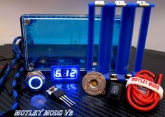 Build your own Box Mod in Parallel or Series . * Hammond 1591B Blue * Blue & Clear Lid Included * 18650 Triple Battery Sled * 16mm Blue Led Button * 3034 mosfet,15k Resistor * Fat Daddy v4 510 Connect