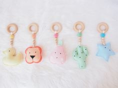 Our new range of teething rattles are made from 100% merino wool felt and feature untreated wooden beads and a teething ring for your little one to munch on during those difficult teething times. Our mini collection includes 5 beautiful designs for your baby to engage with and are great as a gift or for your own little bundle.  Our rattle toys can also be attached to an activity play bar or on the go in a pram (attachment not included)Measuring approximately 18cm long and 8c...