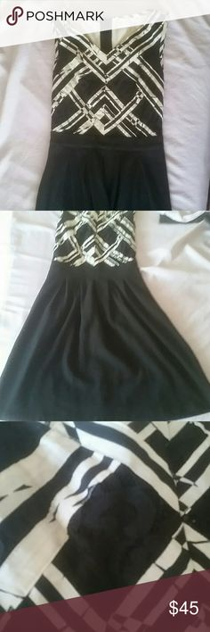 Black and white dress Top part, front is black and white with black lace, the top back doesn't have the lace. Skirt has darts at the waist to help hug curves before flaring out so you can walk. Purchased while in the UK. Worn twice. Total length, about 34 inches Anthropologie Dresses