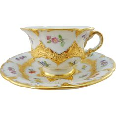 Meissen Cup and Saucer, Heavy Gilding and Hand Painted Flowers