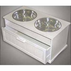 White dog feeding station (http://www.callingalldogs.com/browseproducts/All-In-One-Dog-Feeding-Station---White.HTML)