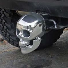 Hitch receiver cover in shape of life size skull made from aluminum.